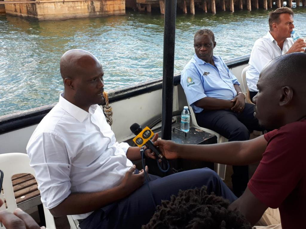 SG on a research boat responding to Journalists